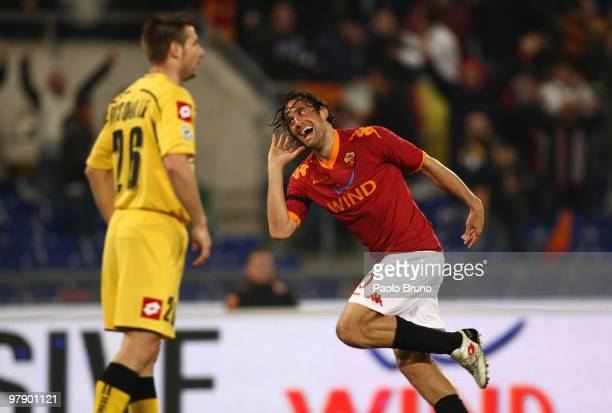 Luca Toni of AS Roma celebrates after scoring the opening goal of the Serie A match between AS Roma and Udinese Calcio at Stadio Olimpico on March 20...