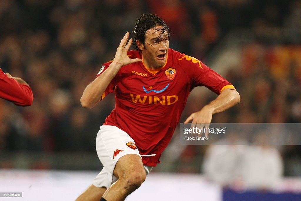 Luca Toni of AS Roma celebrates after scoring the second goal during the Serie A match between AS Roma and FC Internazionale Milano at Stadio...