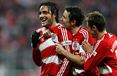 Luca Toni of Bayern celebrates after scoring the winning goal with Mark van Bommel and Miroslav Klose during the Bundesliga match between Bayern...