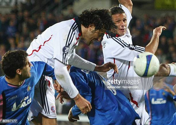 Luca Toni of Bayern Munich scores the winning goal during the UEFA Cup quarter final second leg match between CF Getafe and Bayern Munich at the...