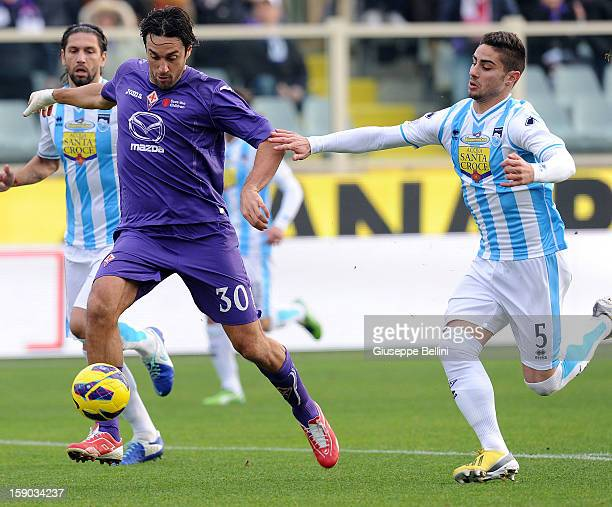 Luca Toni of Fiorentina and Marco Capuano of Pescara in action during the Serie A match between ACF Fiorentina and Pescara at Stadio Artemio Franchi...