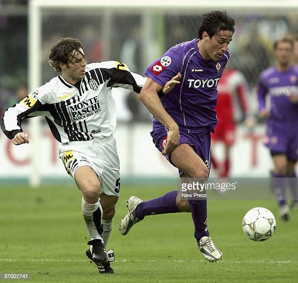 Luca Toni of Florentina is challenged by Francesco Colonnese of Siena during the Serie A match between Fiorentina and Siena at the Artemio Franchi...