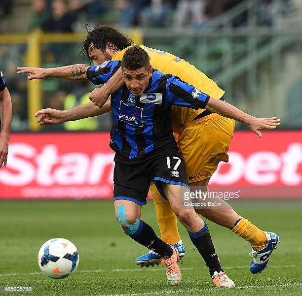 Luca Toni of Hellas Verona and Carlos Carmona of Atalanta in action during the Serie A match between Atalanta BC and Hellas Verona FC at Stadio...