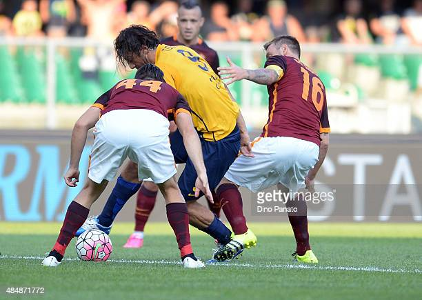 Luca Toni of Hellas Verona battles for the ball with Kostantinos Manolas and Daniele De Rossi of AS Roma during the Serie A match between Hellas...