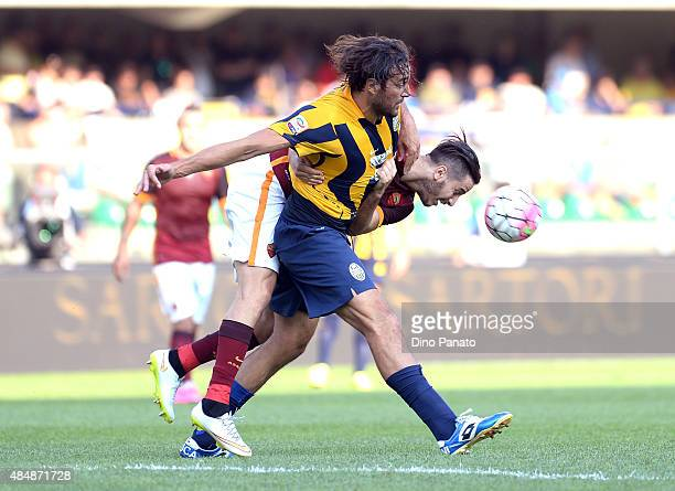 Luca Toni of Hellas Verona battles for the ball with Kostantinos Manolas of AS Roma during the Serie A match between Hellas Verona FC and AS Roma at...