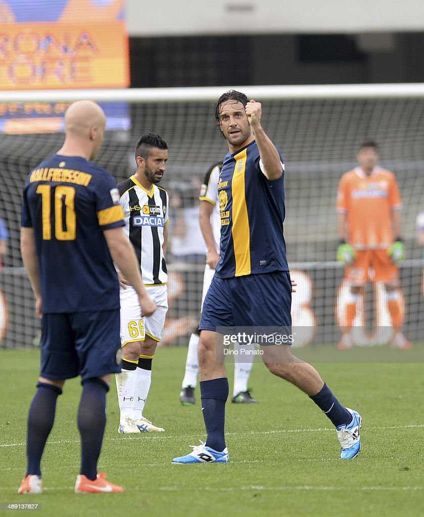 <a gi-track='captionPersonalityLinkClicked' href=/galleries/search?phrase=Luca+Toni&family=editorial&specificpeople=453307 ng-click='$event.stopPropagation()'>Luca Toni</a> (R)of Hellas Verona celebrates after scoring his team's openig goal from the penalty spot during the Serie A match between Hellas Verona FC and Udinese Calcio at Stadio Marc'Antonio Bentegodi on May 10, 2014 in Verona, Italy.