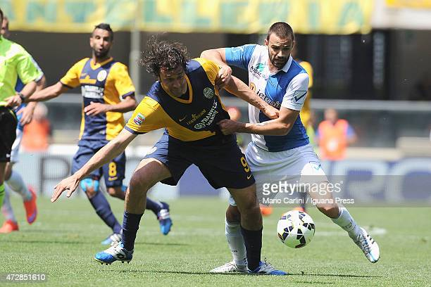 Luca Toni of Hellas Verona FC competes the ball with Ivan Radovanovic of AC Chievo Verona during the Serie A match between AC Chievo Verona and...