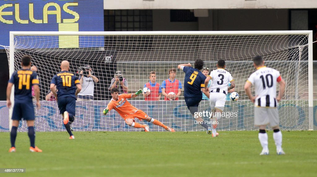 <a gi-track='captionPersonalityLinkClicked' href=/galleries/search?phrase=Luca+Toni&family=editorial&specificpeople=453307 ng-click='$event.stopPropagation()'>Luca Toni</a> of Hellas Verona scores his team's opening goal from the penalty spot during the Serie A match between Hellas Verona FC and Udinese Calcio at Stadio Marc'Antonio Bentegodi on May 10, 2014 in Verona, Italy.