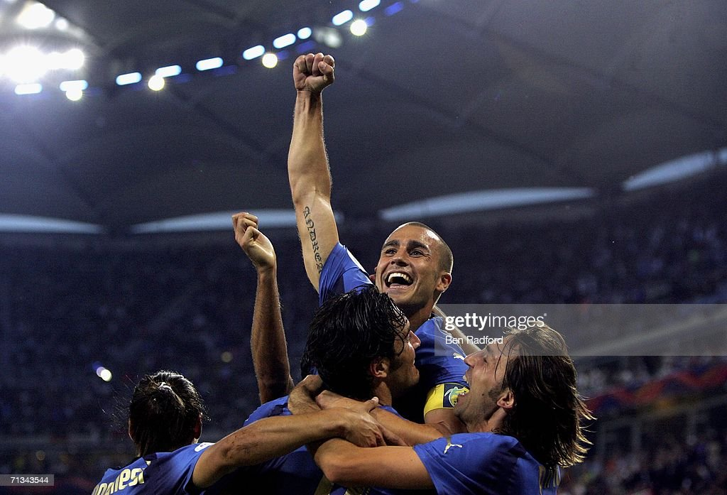 <a gi-track='captionPersonalityLinkClicked' href=/galleries/search?phrase=Luca+Toni&family=editorial&specificpeople=453307 ng-click='$event.stopPropagation()'>Luca Toni</a> (Bottom C) of Italy, celebrates with teammate <a gi-track='captionPersonalityLinkClicked' href=/galleries/search?phrase=Fabio+Cannavaro&family=editorial&specificpeople=204335 ng-click='$event.stopPropagation()'>Fabio Cannavaro</a> (Top) and <a gi-track='captionPersonalityLinkClicked' href=/galleries/search?phrase=Andrea+Pirlo&family=editorial&specificpeople=198835 ng-click='$event.stopPropagation()'>Andrea Pirlo</a>, after scoring his team's second goal during the FIFA World Cup Germany 2006 Quarter-final match between Italy and Ukraine at the Stadium Hamburg on June 30, 2006 in Hamburg, Germany.