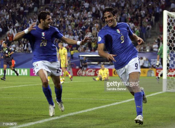 Luca Toni of Italy is congratulated by teammate Simone Perrotta after scoring his team's third goal during the FIFA World Cup Germany 2006...