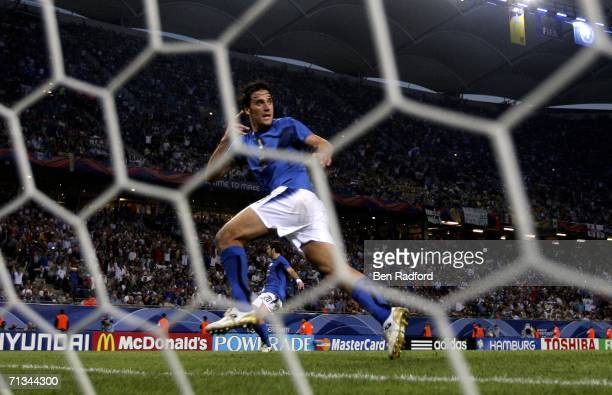 Luca Toni of Italy turns away to celebrate after scoring his team's third goal during the FIFA World Cup Germany 2006 Quarterfinal match between...