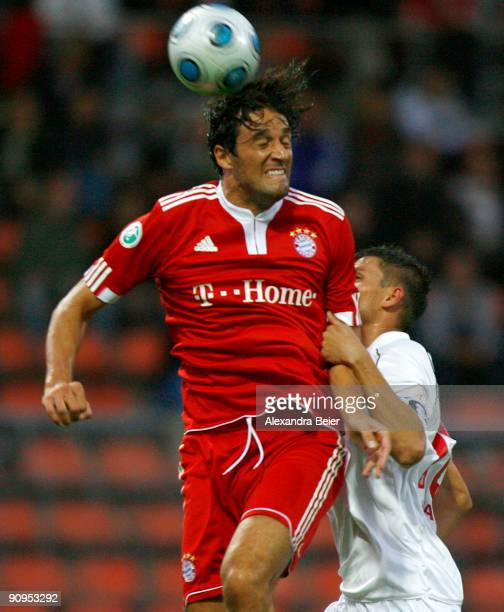 Luca Toni of Muenchen heads for the ball with Alexander Maul of Regensburg during the Third Liga match between Bayern Muenchen II and SSV Jahn...