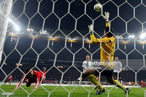 Luca Toni of Muenchen heads his team's fourth goal during the DFB Cup round of 16 match between Eintracht Frankfurt and FC Bayern Muenchen on October...