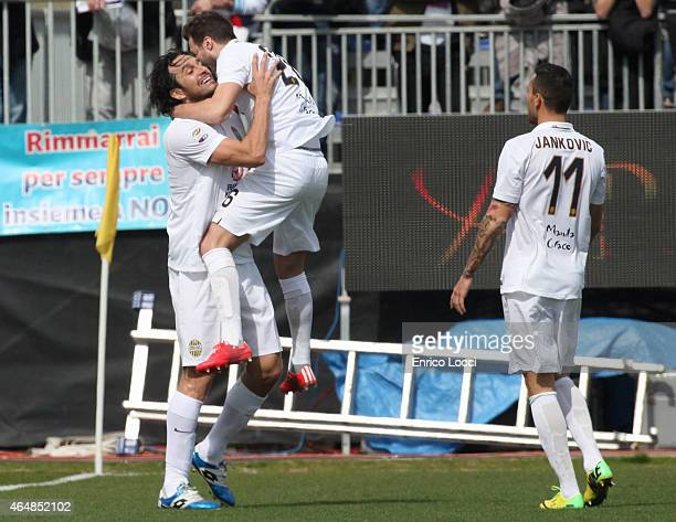 Luca Toni of Verona celebrates with teammates after scoring their first goal during the Serie A match between Cagliari Calcio and Hellas Verona FC at...