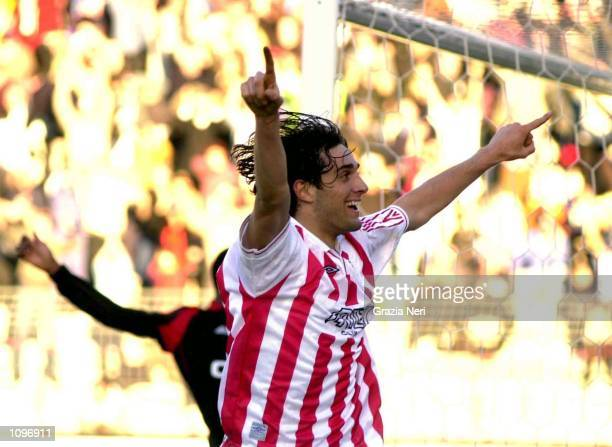 Luca Toni of Vicenza celebartes after scoring during the SERIE A 18th Round League match between Vicenza and Milan played at the Romeo Menti Stadium...