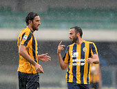 Luca Toni speakes with Gianpaolo Pazzini of Hellas Verona during the Serie A match between Hellas Verona FC and Torino FC at Stadio Marc'Antonio...
