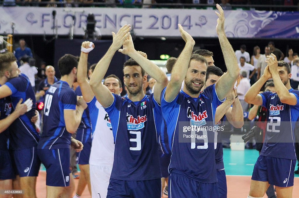 Luca Vettori with his teammate Dragan Travica of Italy celebrate the victory after the FIVB World League Final Six match for the third place between Iran and Italy at Mandela Forum on July 20, 2014 in Florence, Italy.