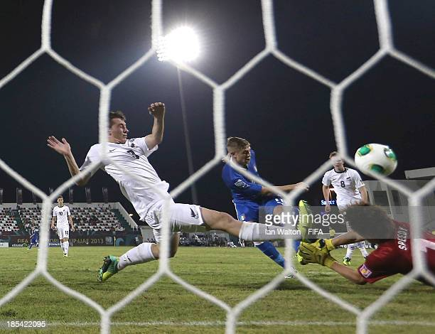 Luca Vido of Italy scores a goal during the Group B FIFA U17 World Cup between Italy and New Zealand at Ras Al Khaimah Stadium on October 20 2013 in...