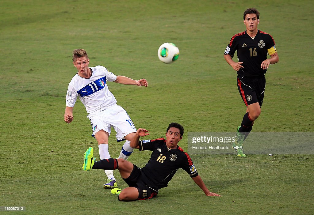 Luca Vido of Italy shoots past Omar Govea of Mexico during the FIFA U-17 World Cup UAE 2013 Round of 16 match between Italy and Mexico at the Mohamed Bin Zayed Stadium on October 28, 2013 in Abu Dhabi, United Arab Emirates.
