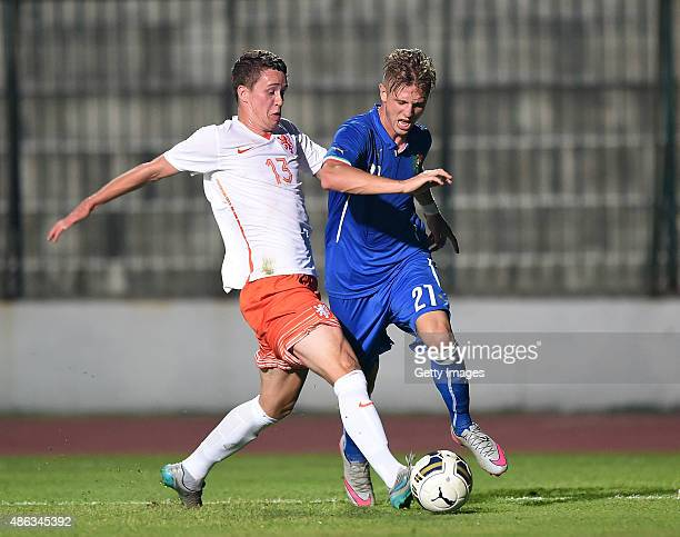 Luca Vido of Italy U19 vies with Netherlands player Frank Sturing during the international friendly match between Italy U19 and Netherlands U19 on...