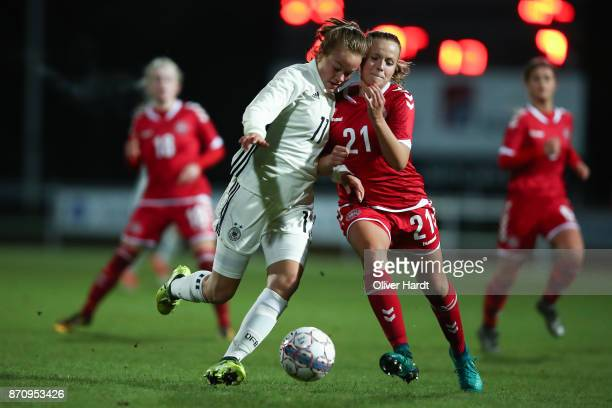 Luca von Achten of Germany and Emilie Pruesse of Denmark compete for the ball during the U16 Girls international friendly match betwwen Denmark and...