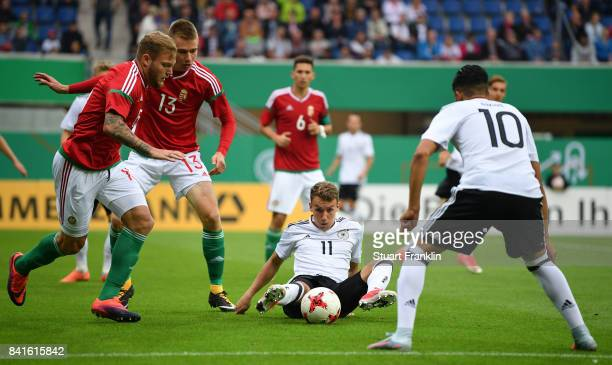 Luca Waldschmidt of Germany U21 is challenged by Attila Szalai and Janos Hegedus of Hungary 21 during the International friendly match between...