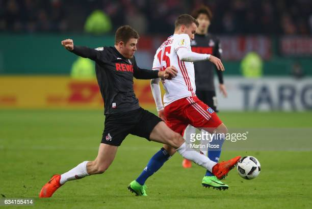 Luca Waldschmidt of Hamburg and Dominique Heintz of Koeln battle for the ball during the DFB Cup round of 16 match between Hamburger SV and 1 FC...