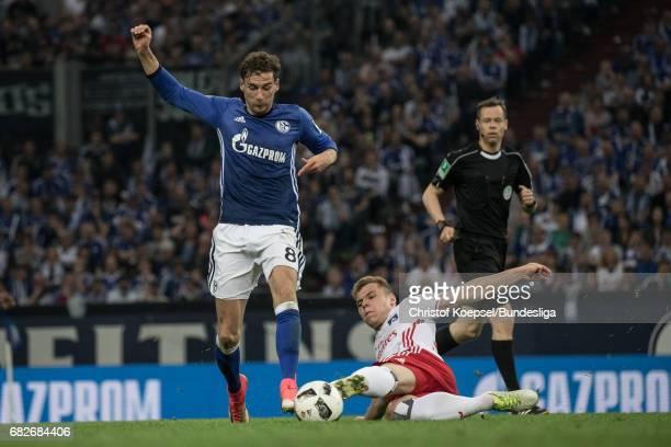 Luca Waldschmidt of Hamburg challenges Leon Goretzka of Schalke during the Bundesliga match between FC Schalke 04 and Hamburger SV at VeltinsArena on...