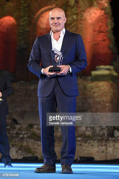 Luca Zingaretti receives the Hamilton Behind The Camera Award during the Nastri D'Argento Awards Ceremony 2015 on June 27 2015 in Taormina Italy