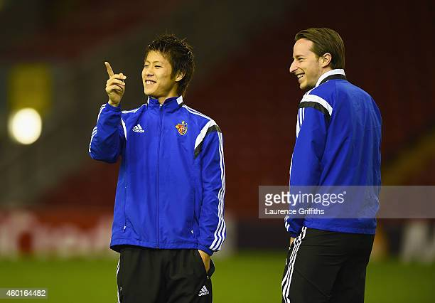 Luca Zuffi and Yoichiro Kakitani of Basel talk during training ahead of the UEFA Champions League match against Liverpool at Anfield on December 8...