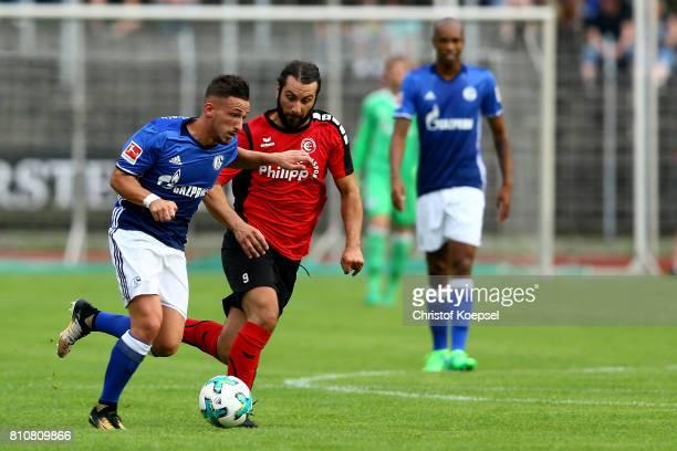 LucaFabian Schulz of Erkenschwick challenges Donis Avdijaj of Schalke during the preseason friendly match between SpVgg Erkenschwick and FC Schalke...