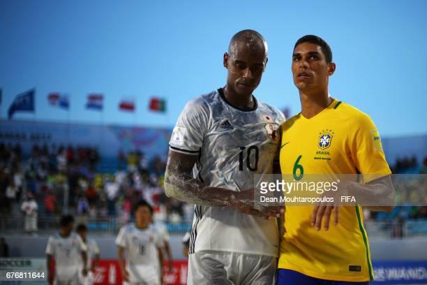 Lucao of Brazil and Ozu Moreira of Japan speak after the FIFA Beach Soccer World Cup Bahamas 2017 group D match between Braziland Japan at National...