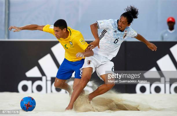 Lucao of Brazil competes for the ball with Masayuki Komaki of Japan during the FIFA Beach Soccer World Cup Bahamas 2017 group D match between Brazil...