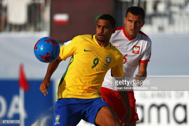 Lucao of Brazil controls the ball in front of Jakub Jesionowski of Poland during the FIFA Beach Soccer World Cup Bahamas 2017 group D match between...