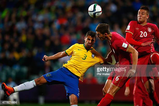 Lucao of Brazil headers the ball with Srdan Babic of Serbia during the FIFA U20 World Cup Final match between Brazil and Serbia at North Harbour...