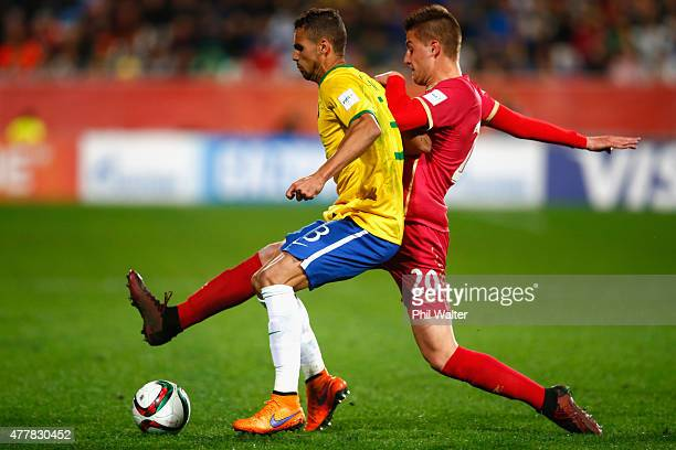 Lucao of Brazil is tackled by Sergej Milinkovic of Serbia during the FIFA U20 World Cup Final match between Brazil and Serbia at North Harbour...