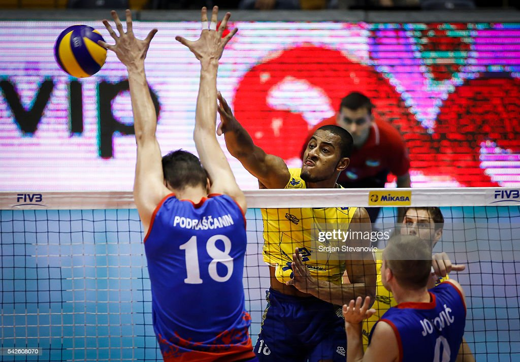 Lucarelli of Brazil spikes the ball as Marko Podrascanin of Serbia attempts to block during the match between Brasil and Serbia on the FIVB World...