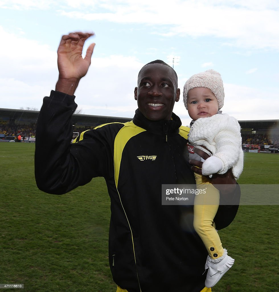 Lucas Akins of Burton Albion celebrates with his daughter on a lap of honour at the end of the Sky Bet League Two match between Burton Albion and Northampton Town at Pirelli Stadium on April 25, 2015 in Burton-upon-Trent, England.