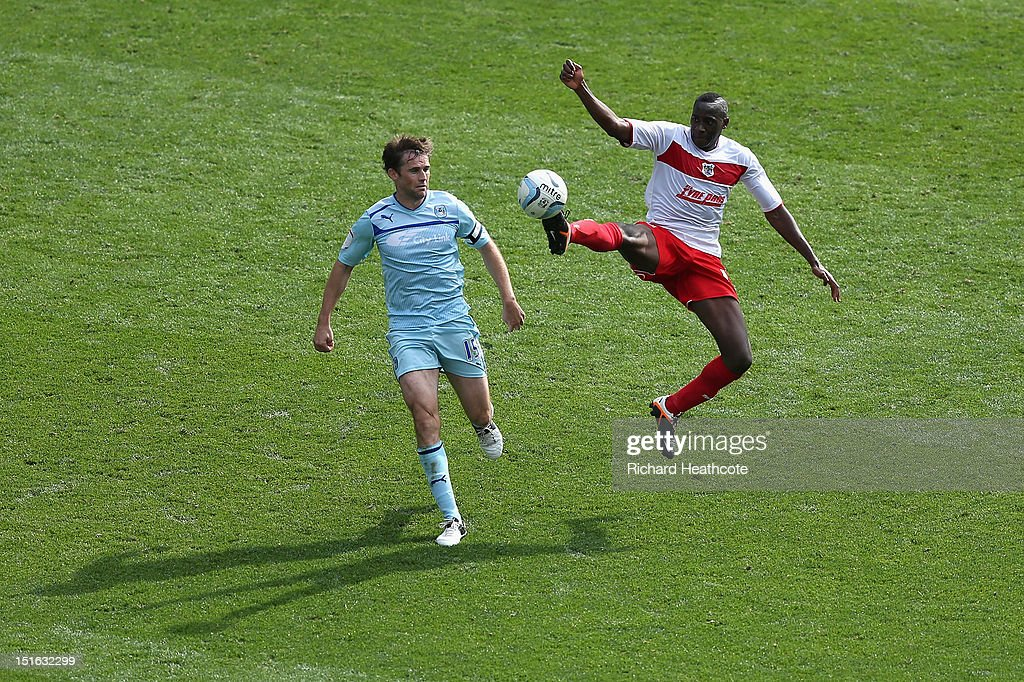 Lucas Akins of Stevenage beats Kevin Kilbane of Coventry to the ball during the npower League One match between Coventry City and Stevenage at The...