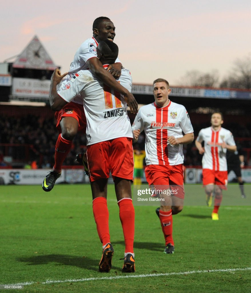 Lucas Akins of Stevenage FC celebrates scoring the 2nd goal with his team mates during the FA Cup second round match between Stevenage FC and...