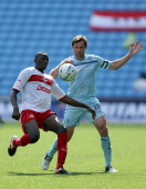 Lucas Akins of Stevenage holds off Kevin Kilbane of Coventry during the npower League One match between Coventry City and Stevenage at The Ricoh...