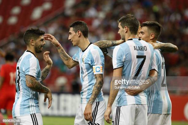 Lucas Alario of Argentina celebrates with teammates after scoring a goal during the International Test match between Argentina and Singapore at...