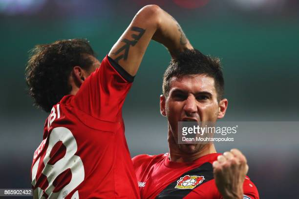 Lucas Alario of Bayer 04 Leverkusen celebrates scoring his teams second goal of the game during the DFB Cup match between Bayer Leverkusen and 1 FC...