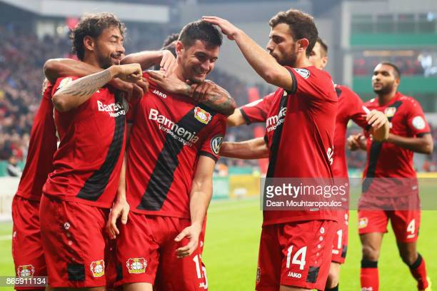 Lucas Alario of Bayer 04 Leverkusen celebrates scoring his teams second goal of the game with team mates during the DFB Cup match between Bayer...