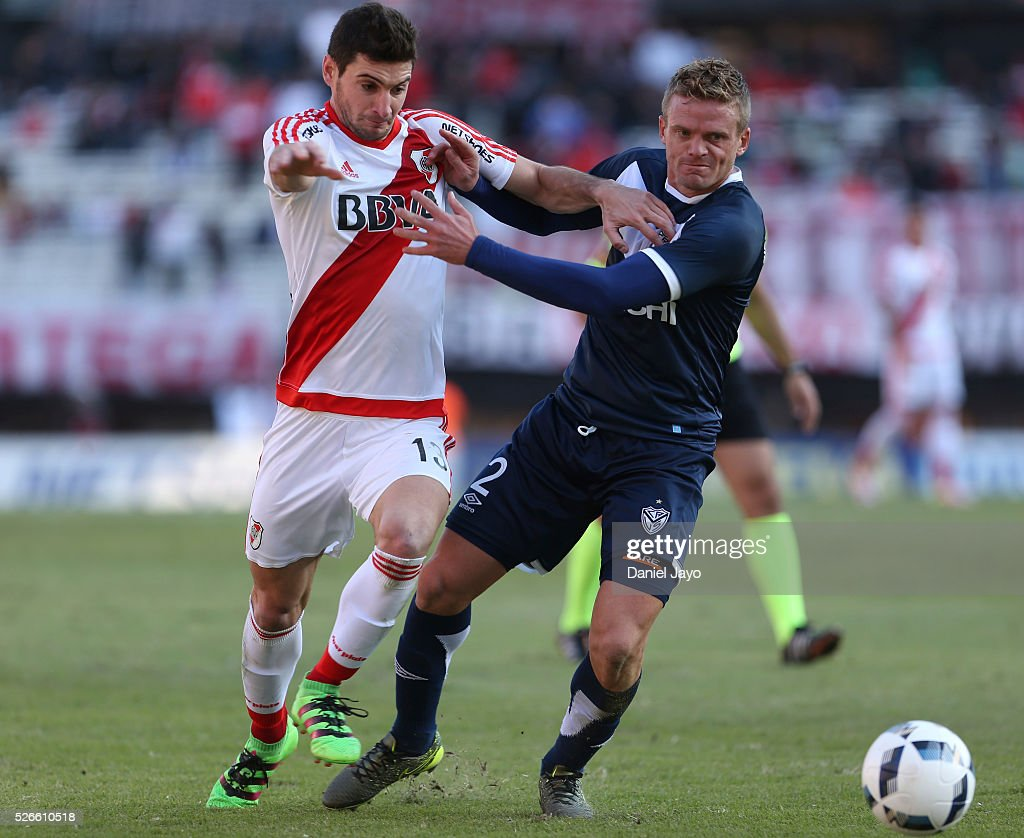 Lucas Alario, of River Plate, (L) and Cristian Nasuti, of Velez Sarsfield, vie for the ball during a match between River Plate and Velez Sarsfield as part of Torneo Transicion 2016 at Antonio Vespucio Liberti Stadium on April 30, 2016 in Buenos Aires, Argentina.