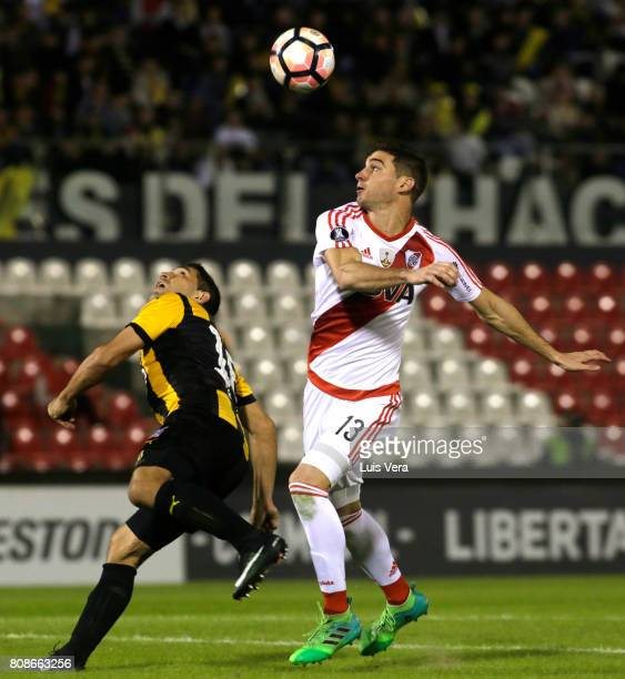 Lucas Alario of River Plate and Luis Cabral of Guarani fight for the ball during a first leg match between Guarani and River Plate as part of round...