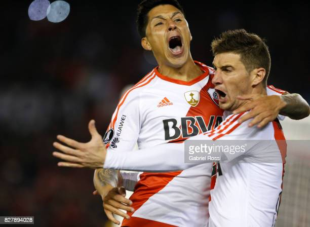 Lucas Alario of River Plate celebrates with teammate Enzo Perez after scoring the first goal of his team during a second leg match between River...