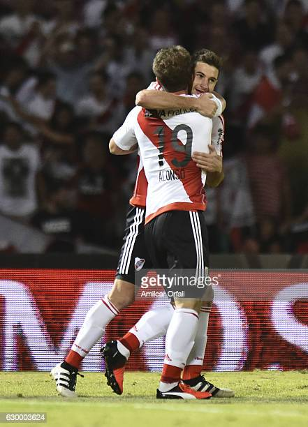 Lucas Alario of River Plate celebrates with teammate Ivan Alonso after scoring the third goal of his team during a final match between River Plate...