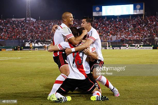 Lucas Alario of River Plate celebrates with teammates after scoring the tying goal of his team during a second leg Semi Final match between Guarani...