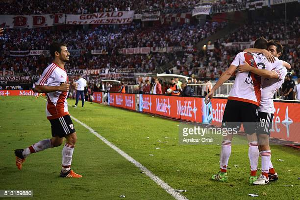 Lucas Alario of River Plate celebrates with teammates after scoring the first goal of his team during a match between River Plate and Independiente...